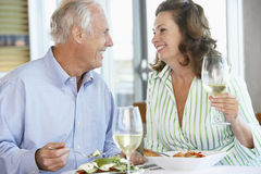 Senior Couple Having Lunch At A Restaurant Stock Photo