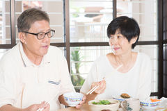Senior couple having meal Royalty Free Stock Image