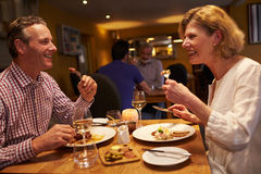 Senior couple having a meal together at a restaurant Royalty Free Stock Photography