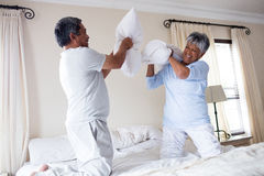 Senior couple having a pillow fight Royalty Free Stock Image