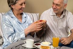Senior couple having romantic morning breakfast Stock Photo