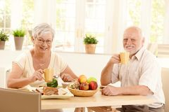 Senior couple having tea at breakfast Royalty Free Stock Image