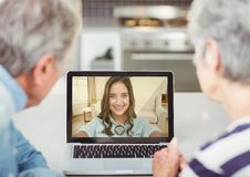 Senior couple having video call with daughter on laptop. At home Stock Images