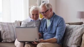 Senior couple having video chat on laptop at home stock video footage