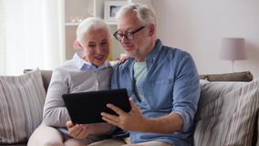Senior couple having video chat on tablet pc stock video footage