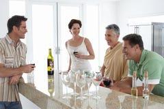 Senior Couple Having Wine With Family Royalty Free Stock Photography