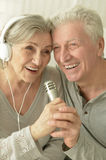 Senior couple with headphones Stock Photos
