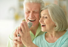 Senior couple with headphones. Portrait of a senior couple and microphone Stock Photography