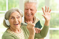 Senior couple with headphones. Portrait of a senior couple and microphone Royalty Free Stock Photos