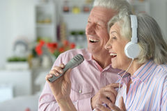 Senior couple with headphones. Portrait of a senior couple and microphone Stock Photos
