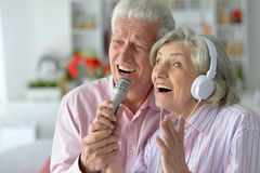 Senior couple with headphones. Portrait of a senior couple and microphone Royalty Free Stock Image