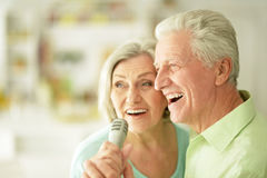 Senior couple with headphones. Portrait of a senior couple and microphone Stock Image