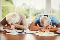 Senior couple with heads on arms Royalty Free Stock Photo