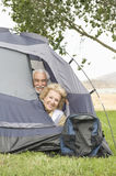 Senior Couple With Heads At Tent Flap Royalty Free Stock Image