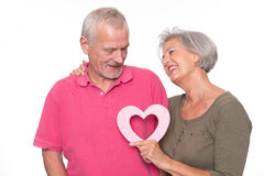 Senior couple with heart Royalty Free Stock Images