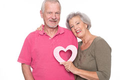 Senior couple with heart Royalty Free Stock Photography
