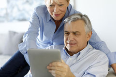 Senior couple and high technology Stock Photo