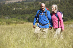 Senior Couple On Hike Through Beautiful Countryside Royalty Free Stock Photography