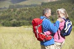 Senior Couple On Hike Through Beautiful Countryside Royalty Free Stock Photos