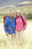 Senior Couple On Hike Through Beautiful Countryside Royalty Free Stock Photography