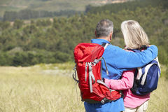 Senior Couple On Hike Through Beautiful Countryside Stock Photography