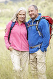 Senior Couple On Hike Through Beautiful Countryside Royalty Free Stock Images