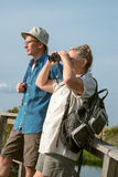Senior Couple Hiking and Birdwatching Stock Photo