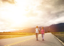 Senior couple hiking on the country road Stock Images