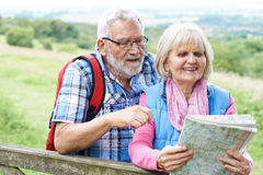 Senior Couple Hiking In Countryside Stock Photos