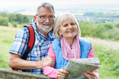 Senior Couple Hiking In Countryside With Map Royalty Free Stock Images