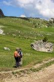Senior couple hiking in the Dolomites mountain Stock Image