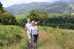 Senior couple hiking in mountains Royalty Free Stock Image