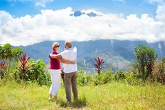 Senior couple hiking in mountains and jungle Royalty Free Stock Images