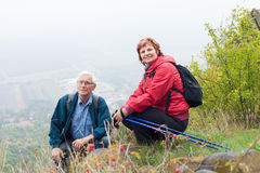 Senior couple hiking and resting in nature stock photos