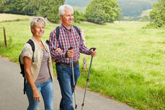 Senior couple hiking in summer. Happy senior couple hiking in summer in nature royalty free stock photography