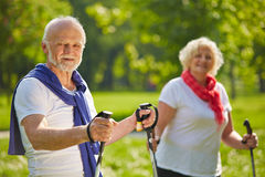 Senior couple hiking together in summer Royalty Free Stock Image