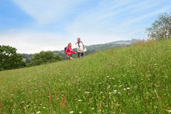 Senior couple on a hiking trip in meadow Royalty Free Stock Photo