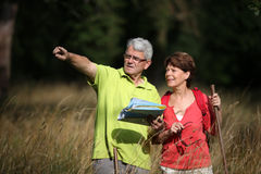 Senior couple on a hikking day stock images