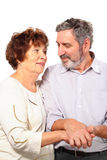 Senior couple hold for hands, hug Stock Photography