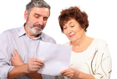 Senior couple hold paper list in hands Royalty Free Stock Photography