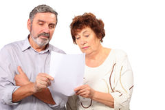 Senior couple hold paper list in hands Royalty Free Stock Photos