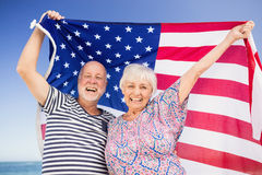 Senior couple holding american flag. On a sunny day Stock Image