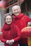 Senior Couple Holding Chinese Lantern Stock Photography