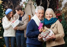 Senior Couple Holding Christmas Presents With Stock Photography
