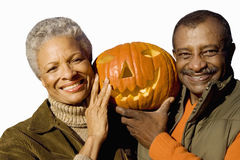 Senior couple holding craved pumpkin, cut out stock photography