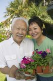 Senior couple holding flowers Stock Photo