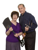 Senior Couple Holding Gardening Tool Stock Photo