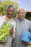 Senior Couple Holding Gifts Royalty Free Stock Images