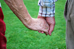 Senior couple holding hands Royalty Free Stock Photos