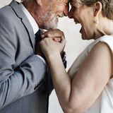 Senior couple holding hands each other Royalty Free Stock Photos
